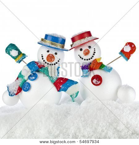 Two Cheerful dancing snowmans in a striped scarfs, mittens and cylinder hat isolated on white background
