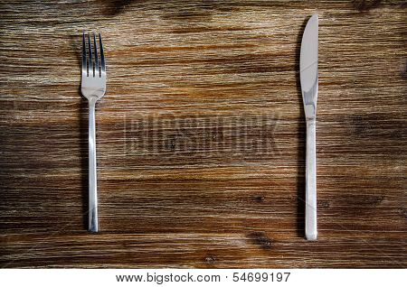Knife And Fork Set On A Wooden Table