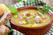 stock photo of meals wheels  - Freshly made potato soup with bacon strips and Vienna sausage wheels - JPG