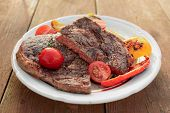 stock photo of wagyu  - Kobe beef ribeye steak with grilled vegetables on old table - JPG