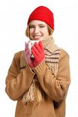 picture of buff  - Young smiling woman in brown sweater buff scarf red cap and gloves standing with cup isolated on white background - JPG