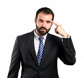foto of sarcasm  - Businessman making a crazy gesture over white background - JPG