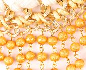 stock photo of macrame  - Golden pearls with macrame close - JPG