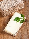 stock photo of crisps  - Crisp bread with fresh cheese and parsley - JPG