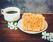 Black Coffee And Rice Puffed On Wood Background
