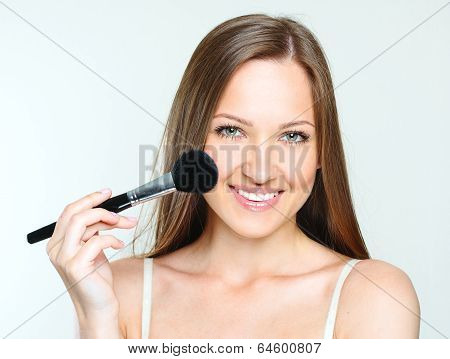 beautiful woman making makeup