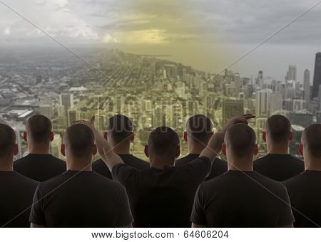 Group cloning man over night city sky