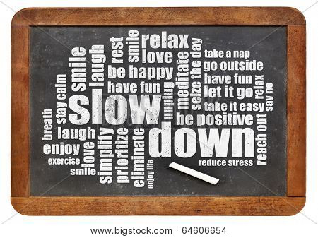slow down and relax - reducing stress tips in a form of a word cloud on a vintage blackboard