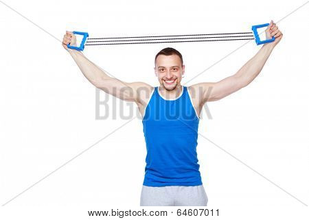 Happy sportsman doing fitness exercises with expander over white background