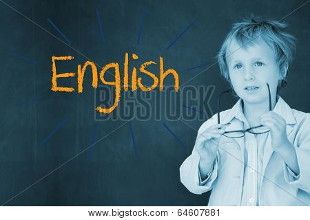 The word english against schoolboy and blackboard