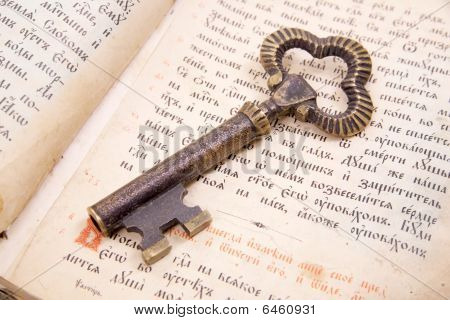 Closeup Of Key Placed On Vintage Book  Bible