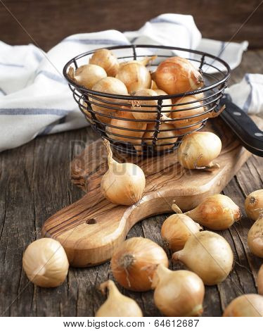 Pearl Onions On A Wooden Table