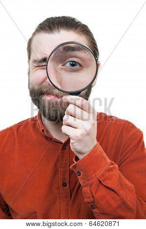 Man Peering through Magnifying Glass