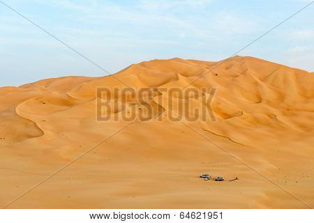 People With Tents And Cars Among Dunes In Rub Al-khali Desert (oman)