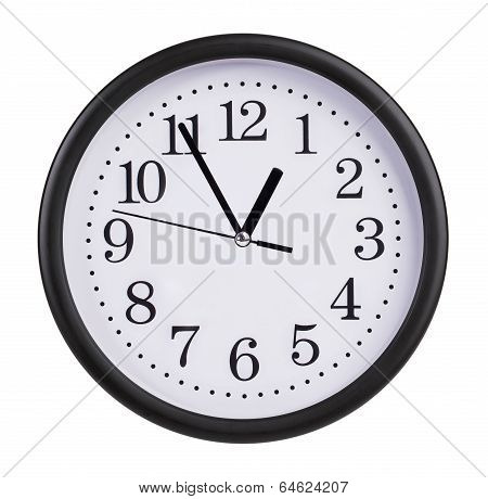 Office Clock Shows Five Minutes To An Hour