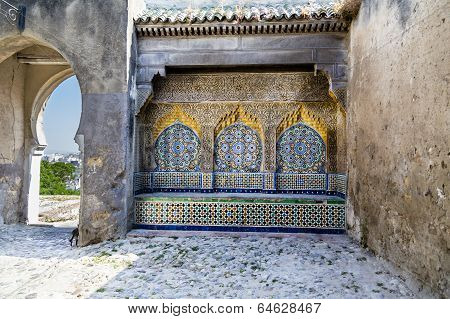 Tiled and carved alcove in Casbah, Tangier with distant skyline