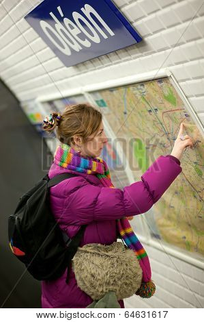 Tourist Girl In Parisian Metro, Looking At The Map