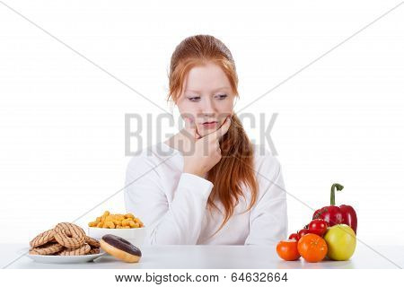 Wondering Whether To Eat Sweets Or Vegetables
