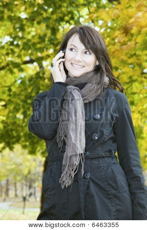 Smiling Girl On The Phone