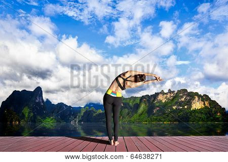 Young Woman Is Practicing Yoga