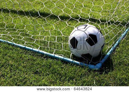 Soccer ball at goal
