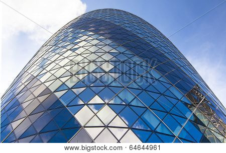 LONDON, UK - APRIL 24, 2014: Ghrkin building glass windows texture reflects the sky. The modern gla