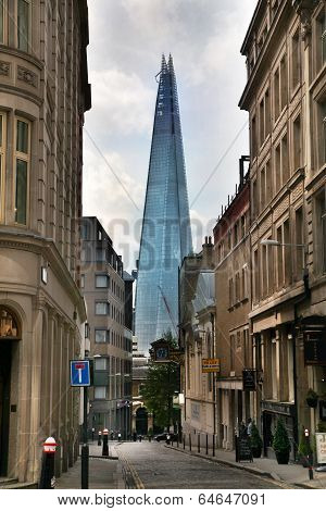 LONDON, UK - APRIL 24, 2014: Shard of glass on the river Thames, office and residential building in