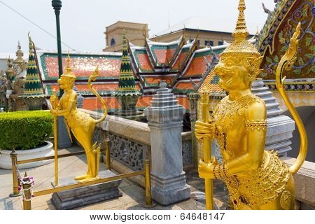 BANGKOK, THAILAND - MARCH 23: Wat Phra Kaew or Grand Palace exterior at day time on March 23, 2014 in Bangkok, Thailand. Wat Phra Kaew is the most visited travel destination in Bangkok