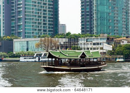 BANGKOK, THAILAND - MARCH 23: Tourists travel on the Chao Phraya river on a boat on March 23, 2014 in Bangkok, Thailand. Boating by the river is the cheapest and most fun way to get around Bangkok.
