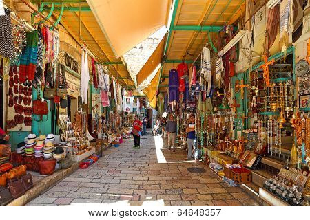 JERUSALEM, ISRAEL - AUGUST 21, 2013: Bazaar in Old City of Jerusalem with variety of middle east traditional products and souvenirs. It is very popular with tourists and pilgrims visiting Holy Land.