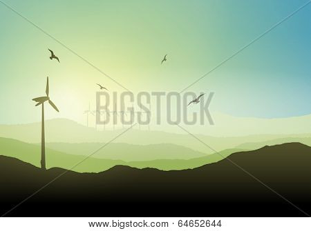 Landscape with wind turbines against a sunrise sky