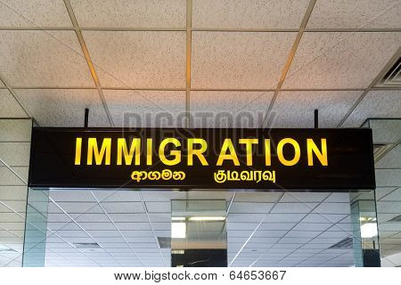 COLOMBO, SRI LANKA - FEBRUARY 19, 2014: Immigration sign at Bandaranaike International Airport, one of the two international airports serving the city of Colombo.