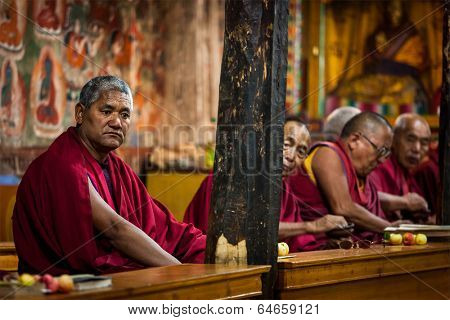 THIKSEY, INDIA - SEPTEMBER 4, 2011:Tibetan Buddhist monks during prayer in Thiksey gompa (Buddhist monastery)  of the Yellow Hat (Gelugpa) sect - the largest gompa in central Ladakh