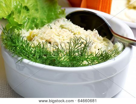 Delicious salad with vegetables and fresh herbs