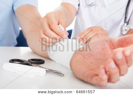 Doctor Bandaging Patient