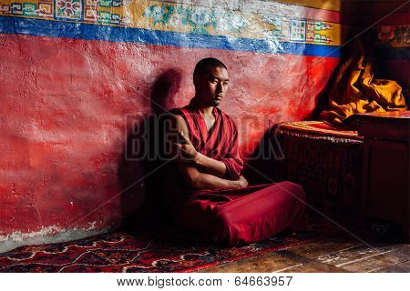 DISKIT, INDIA - SEPTEMBER 12, 2012: Unidentified Tibetan Buddhist monk in Diskit gompa. Diskit gompa is the oldest and largest Buddhist monastery (gompa) in the Nubra Valley of Ladakh, India
