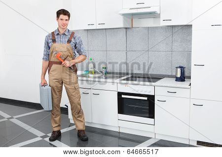 Young Plumber Holding Wrench