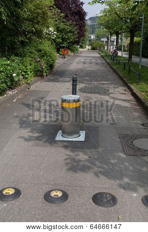 Small Street Secured With Pole Against Unauthorized Cars