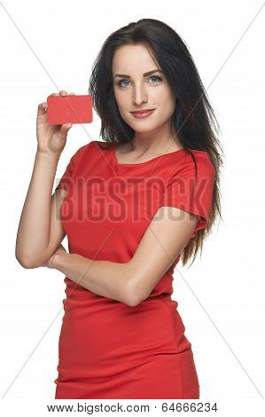 Woman in red dress showing blank business card