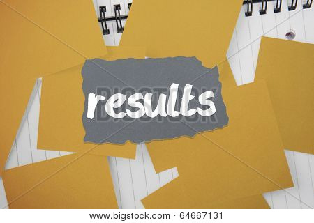 The word results against yellow paper strewn over notepad