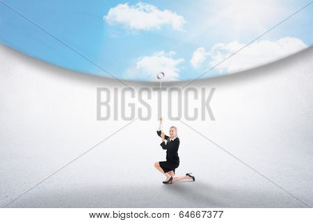 Composite image of businesswoman pulling down blue sky over white room