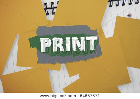 The word print against yellow paper strewn over notepad