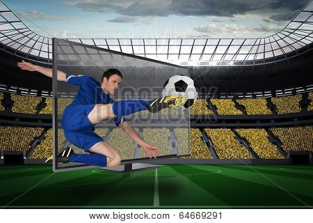 Composite image of fit football player kicking ball through tv against vast football stadium with fans in yellow