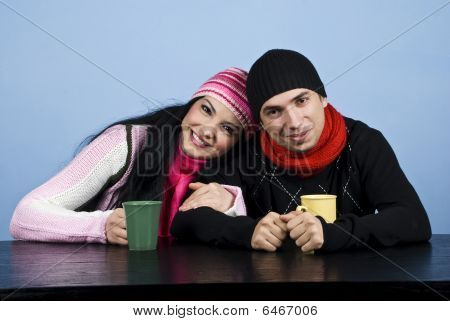 Affectionate Couple In Winter Clothes Drinking Tea