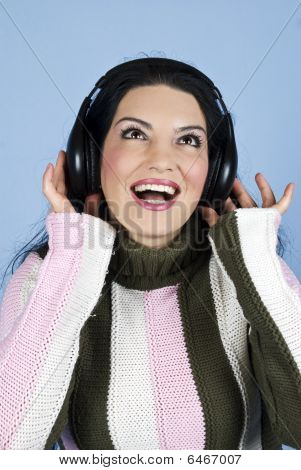 Happy Woman Enjoying Music In Headphones