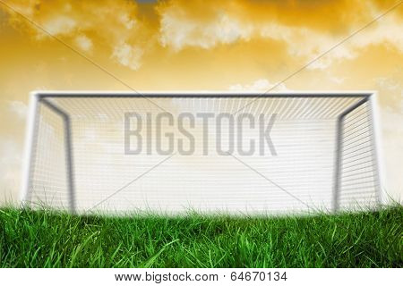 Digitally generated goalpost on grass under yellow sky