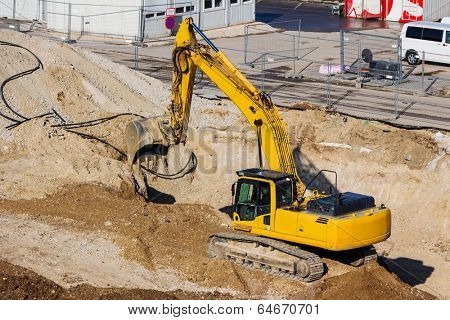 excavator on a construction site. excavator bucket with soil, ground work.