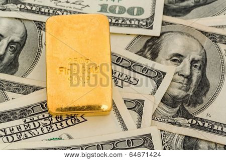 gold bars on dollar bills, symbolic photo for gold reserves, exchange rates, investment, security