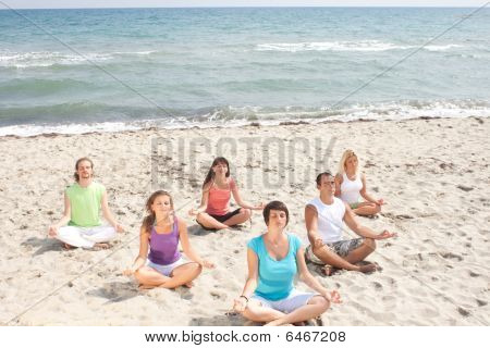 Meditation Group On Beach