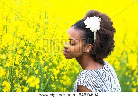 Outdoor Portrait Of A Young Beautiful African American Woman In A Rape Colza Field - Black People